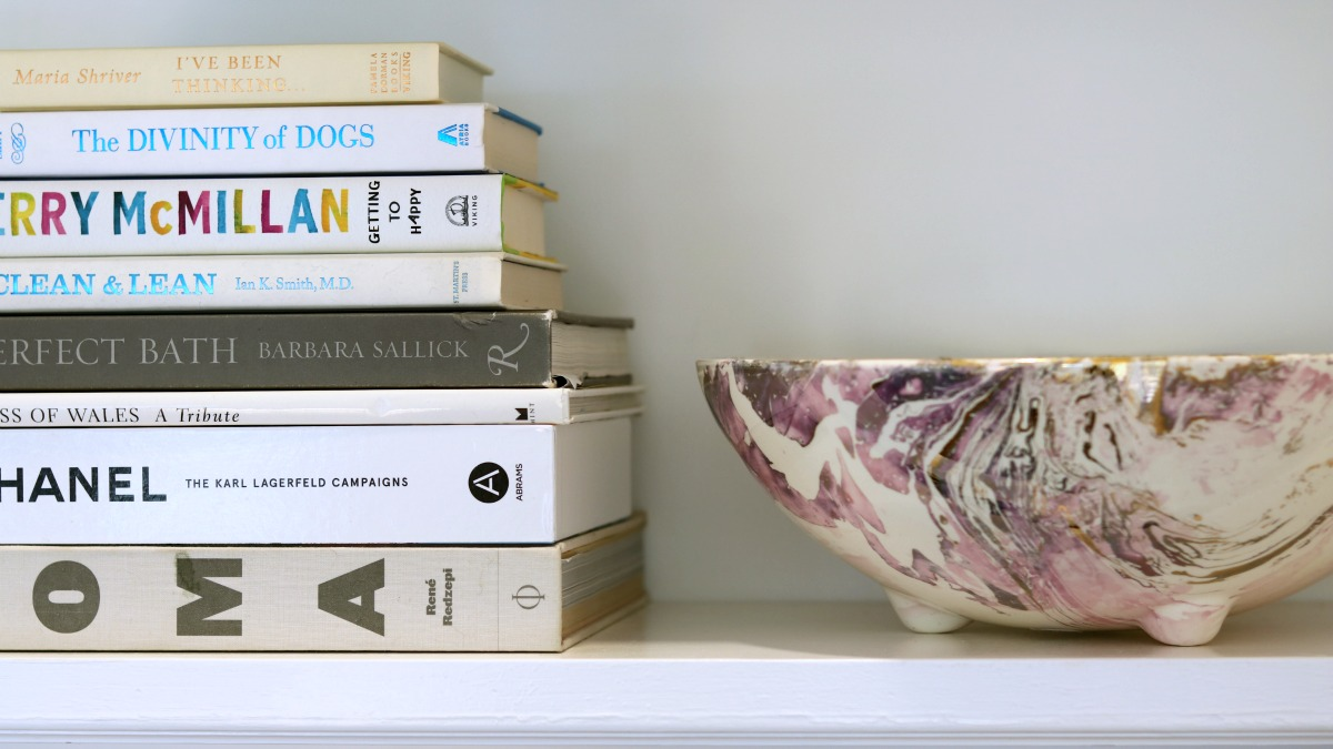 The art of styling your bookcase is far more involved than one might imagine. Consider hiring a stylist.