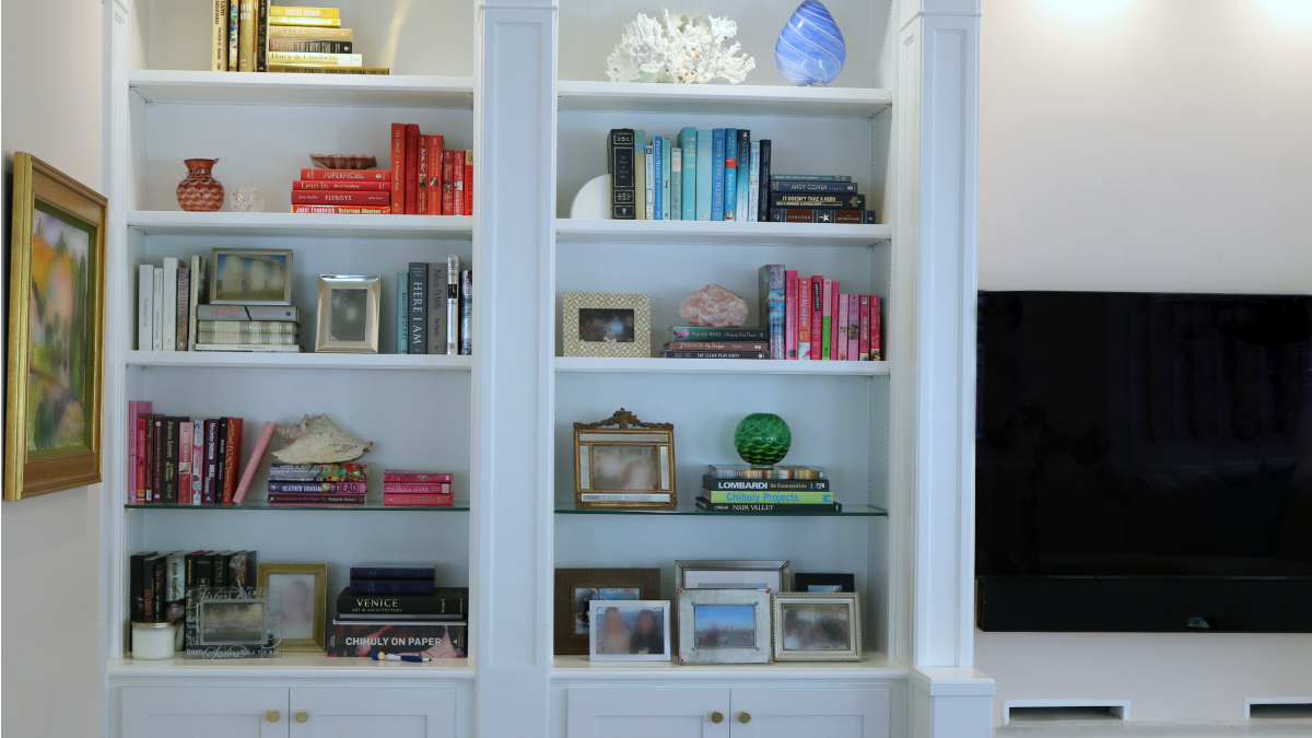 Considering speaking with a professional designer (a.k.a. ME) to see how an expertly styled bookshelf can improve the look of any room in your home or office.